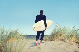 Businessman holding surfing board