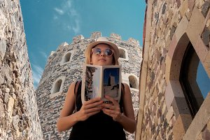 young tourist girl looking at a brochure in Rabati Castle