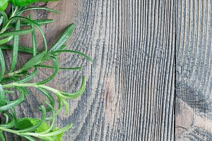 Basil, mint and rosemary. Fresh green herbs laying on wooden background, flat lay, vertical, copy space