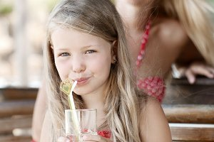 Little girl drinking cocktail