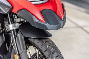 Red motorbike detail on wheel
