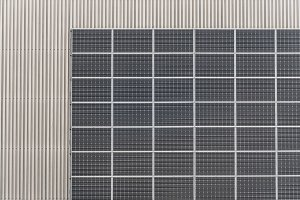 Photovoltaic panels on industrial metal facade
