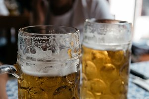 Two beer jars and blur background.