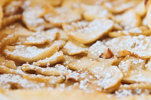 Homemade rustic apple pie close up.