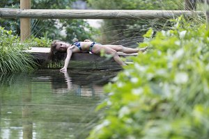 Girl lying on the footbridge