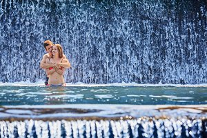 Happy couple in waterfall
