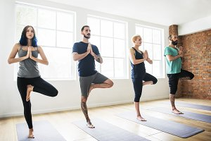 Diverse people practising yoga