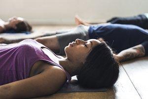 Diverse people practising yoga