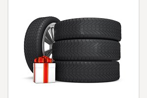 Car wheels with big white gift box