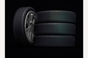 Car wheels, black background.