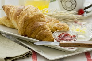 breakfast croissant with jam and but