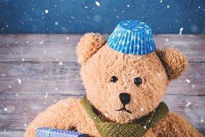 Christmas background with a teddy bear