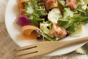 Salad greens, tomato, lettuce, cucum