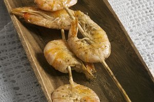 two skewers of shrimp, grilled wit