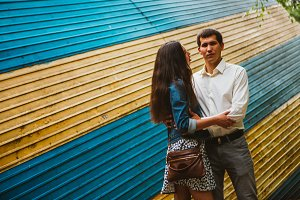 Beautiful young couple on the city background