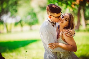 Young beautiful couple on a blurred natural background