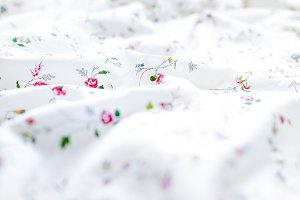 Wrinkled White and floral bed sheets
