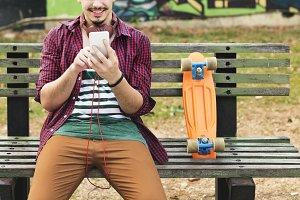 Man sitting and using phone