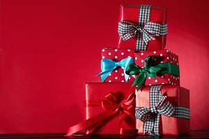 Bright presents on red background