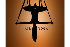 The silhouette of Young woman doing anti-gravity aerial yoga
