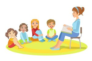 Group Of Small Kids Sitting Around The Teacher Reading A Story