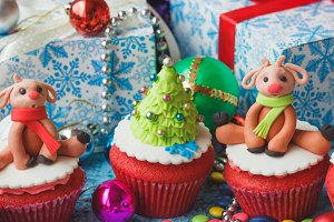 Christmas cupcakes with different decorations made from confectionery mastic