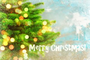 Blured holiday background with Christmas tree and bokeh lights