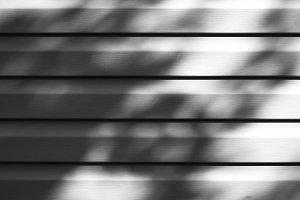 Horizontal black and white siding texture background