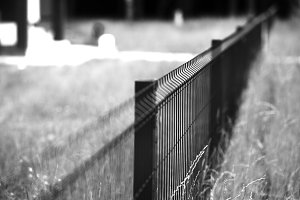 Diagonal perspective fence bokeh background