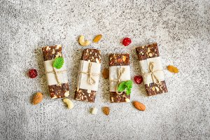 Healthy snack bars of dried fruits and nuts on  gray background