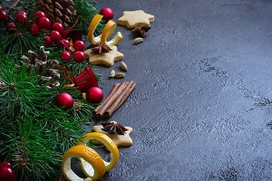 Christmas background border of fir branches and Christmas toys and spices