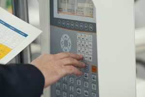 Energy security - system management panel. Man worker manipulates for Industrial remote control