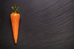 glass carrot on black background