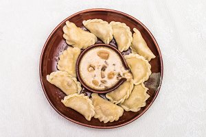 Dumplings in clay bowl