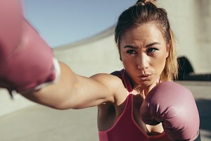 Female boxer practicing boxing