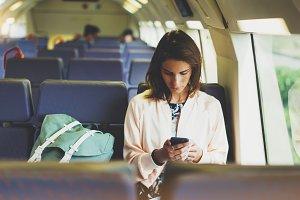 She uses a smartphone on a trip