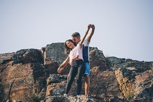 Couple in love on the top of a mountain