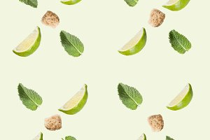 Lime, sugar and mint on a white background.