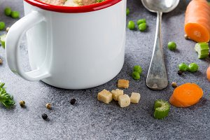 Homemade pea soup with sausage and croutons