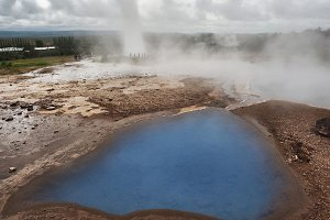 Blue lake at the geyser valley in Iceland