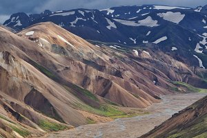 Valley National Park Landmannalaugar. On the gentle slopes of the mountains are snow fields and glaciers. Magnificent Iceland in August