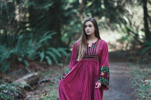 Beautiful Boho Girl Walking in Woods