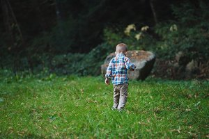 Little Redhead Boy Walking in Park
