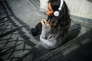 African woman listening to music