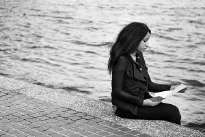 Woman sitting and reading outdoor