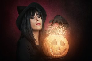 woman like witch with pumpkin