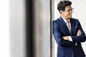 Businessman standing and smiling