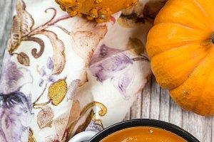 Cream of pumpkin in bowl.