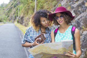 friendly young girls trip with map