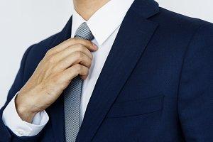 Businessman arranging his neck tie